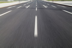 Fast drive on asphalt Royalty Free Stock Photos