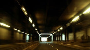 Fast driver. Fast driving throug a tunnel in the night. The picture shows you speed and danger Royalty Free Stock Photos