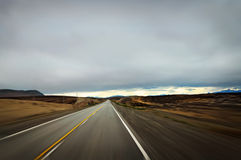 Fast Driving. Shot of the open road from a fast moving car, with ominous sky in the background, at Patagonia, Argentina stock photo