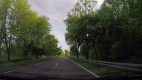 Fast driving car through non urban road. Windscreen inside car view on fast driving through non urban road during spring afternoon stock video