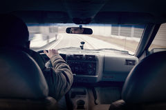 Fast driving a car - third person view. Fast driving a car - shot from third person perspective stock photo