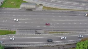 Fast-driving car traffic  on city highway, view from above. Stock footage stock video footage