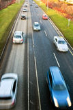 Fast driving cars on road Stock Photo
