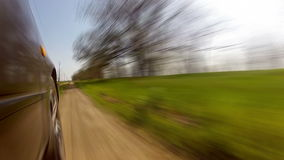 Fast driving on a country road Royalty Free Stock Images