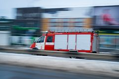 Fast driving fire truck in a city stock image