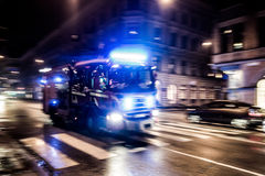 Fast driving fire truck. In a night city Royalty Free Stock Photos