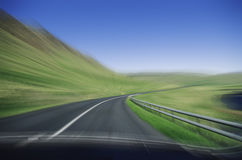 Fast driving on mountain road Royalty Free Stock Photo