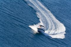 Fast driving yacht on the sea Royalty Free Stock Images