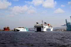 Fast ferry passengers and roro vessel sailing into the port of Algeciras. Stock Images