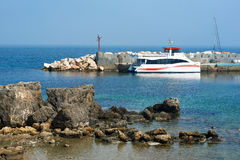 Fast ferry at the lagoon of Tabarca island. Spain Royalty Free Stock Photo