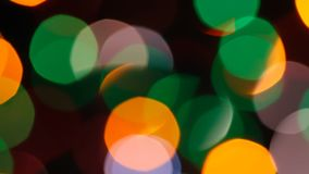 Fast flashing of medium size bright blurred festive and colorful Christmas lights stock footage