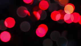 Fast flashing of small size bright blurred festive and colorful Christmas lights stock footage
