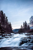 Fast flowing of a mountain river. Nature and fast flowing of a mountain river Royalty Free Stock Photography