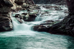 Fast flowing of a mountain river. Nature and fast flowing of a mountain river stock image