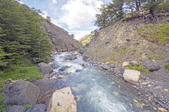 Fast Flowing Mountain Stream in a Narrow Canyon Stock Photography
