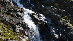 Fast flowing mountain waterfall down slippery mountain side. On the island of senja, northern norway stock video