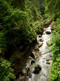 Fast flowing river in Bavarian mountains Stock Photography