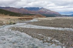 Fast flowing river hunging bank stock photo