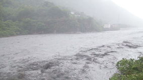 Fast flowing river during typhoon slow motion stock video footage