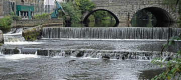 Fast flowing river. A weir on the river Tavy on the outskirts of Tavistock in Devon, UK Stock Photos