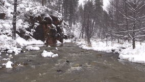 Fast Flowing Stream in Winter stock video footage
