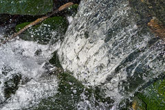Fast flowing water from a culvert Royalty Free Stock Photography