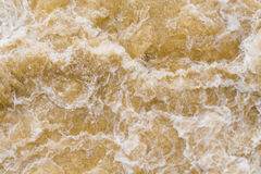 Fast flowing water in the dam Royalty Free Stock Image