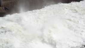 Fast flowing water at a dam stock video footage