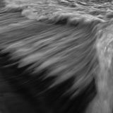 Fast flowing water in long exposure for background and cover photo - black and white. Milky Stock Image