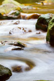 Fast flowing water in the mountain Stock Photo