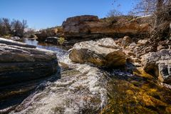 Fast flowing water in Sabino Creek. Water quickly flows past the rocks in Sabino Creek in Tucson, Arizonav Royalty Free Stock Images