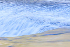 Fast and flowing waterfall  background Stock Photos