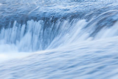 Fast and flowing waterfall  background Royalty Free Stock Photo