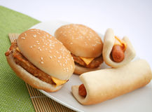 Fast Food. A meal of fast food: cheeseburger and hot-dogs Royalty Free Stock Photo