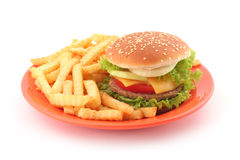 Fast food. Burger with french fries on orange plate stock photography