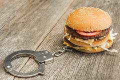 Fast food addicted stock photography