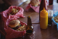 Fast food and beer bottle on table Royalty Free Stock Images