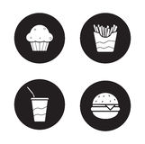 Fast food  black icons set. Burger and french fries circle symbols. Soda drink with straw and muffin white silhouettes illustrations. Unhealthy fat eating Royalty Free Stock Images