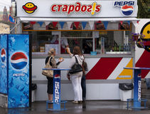 Fast food booth with Pepsi advertisements on Moscow street. Royalty Free Stock Image