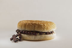 Fast food bread and Holy Rosary Stock Photos