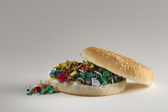 Fast food bread and pins: take care of your health, choose slow food Stock Photography