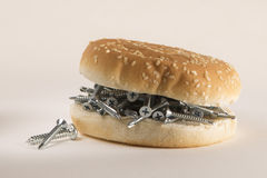 Fast food bread and screws: junk diet Stock Photography