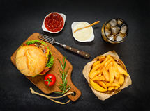 Fast Food Burger with Cola and French Fries. Top View of Burger Sandwich with French Fries, Cold Cola and Ketchup Stock Images