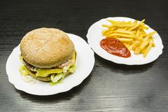 Fast food or burger and french fries with ketchup. Stock Image