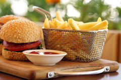 Fast food burger with french fries. On a wooden board Stock Photo