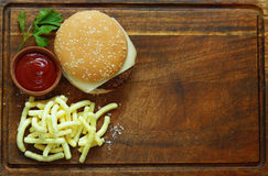 Fast food burger with french fries. On a wooden board Royalty Free Stock Photography