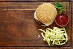 Fast food burger with french fries. On a wooden board Stock Images
