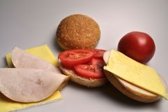 Fast food - burger with sausage, cheese and tomato royalty free stock images