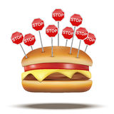 Fast food burger with STOP signs Royalty Free Stock Photo