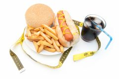 Fast food burger with tape measure Royalty Free Stock Images